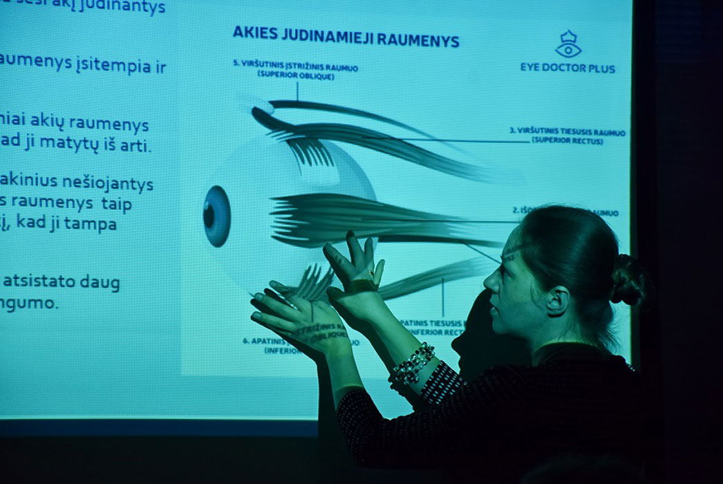 Sigita giving a lecture showing the anatomy of the eye